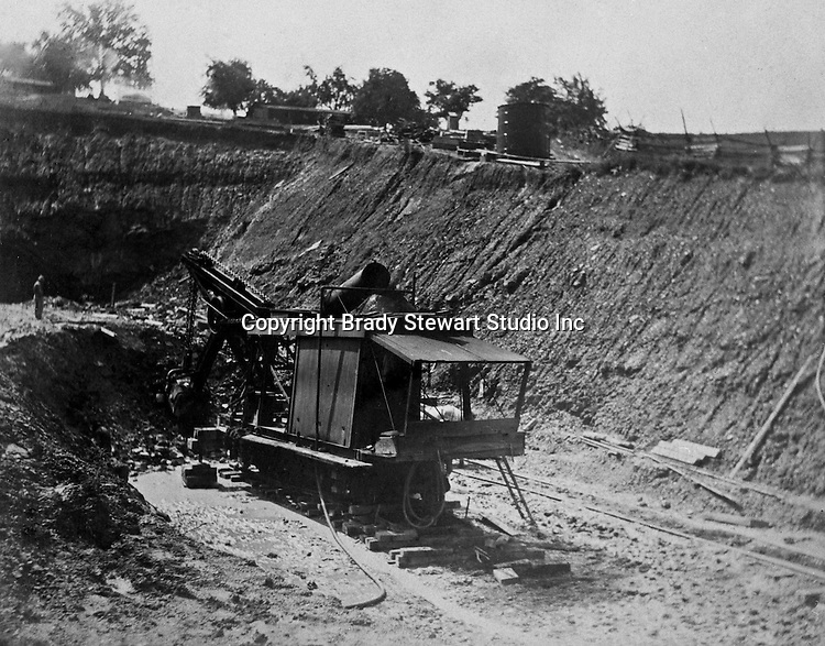 Client:  Wabash Railroad<br /> Product: Barnhart's Railroad Ditcher<br /> Manufacturer: Marion Power Steam Shovel Company<br /> <br /> Hopedale OH:  West approach to the Spellacy Tunnel.  View of railroad steam shovel clearing the entrance of the tunnel.  The Pittsburgh, Toledo, and Western Railroad Company, owned by the famous George J. Gould,  hired Brady Stewart to document the track and tunnel construction between Hopedale Ohio, and downtown Pittsburgh.