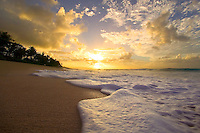 small waves on a beautiful sandy beach during cloudy sunset