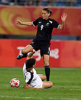 USWNT midfielder (7) Shannon Boxx tackles the ball away from  New Zealand forward (9) Amber Hearn while playing at Wulihe Stadium. The USWNT defeated New Zealand, 4-0, during the 2008 Beijing Olympics in Shenyang, China.  With the win, the USWNT won group G and advanced to the semifinals.