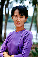 Aung San Suu Kyi, Democratic leader of Burma, political prisoner & 1991 Nobel Peace Prize recipient, Yangon, Burma/Myanmar 1996.<br /> Although the politics of Burma have stabilized somewhat in recent years, the Burmese military refused to recognize the elections won by Aung San Suu Kyi and her National League for Democracy (NLD) in 1990, instead seizing all power and placing her under house arrest for 15 years. While still imprisoned, she was awarded the Nobel Peace Prize in 1991 and was cited by the Nobel Committee as one of the most extraordinary examples of civil courage in Asia in recent decades. <br /> I was able to meet Aung San Suu Kyi shortly after she was initially freed from house arrest for a short period and was deeply impressed by her dignity and inner strength during her ongoing struggle for democracy. This day was the first time in six years she had been able to leave her house for the New Year and the NLD members swarmed her front lawn in joyous celebration.