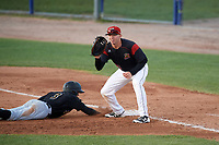 Batavia Muckdogs first baseman Ben Fisher (36) waits for a pickoff attempt throw as Brett Pope (3) dives back to the bag during a game against the West Virginia Black Bears on August 5, 2017 at Dwyer Stadium in Batavia, New York.  Batavia defeated West Virginia 3-2.  (Mike Janes/Four Seam Images)