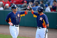 Houston Astros third baseman Brandon Laird #4 is congratulated by Rene Garcia #69 after hitting a home run during a Spring Training game against the St. Louis Cardinals at Osceola County Stadium on March 1, 2013 in Kissimmee, Florida.  The game ended in a tie at 8-8.  (Mike Janes/Four Seam Images)