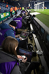 Press photographers editing their pictures after West Bromwich Albion took on Leeds United in a SkyBet Championship fixture at the Hawthorns. Formed in 1878, the home team were relegated from the English Premier League the previous season and were aiming to close the gap on the visitors at the top of the table. Albion won the match 4-1 watched by a near-capacity crowd of 25,661.