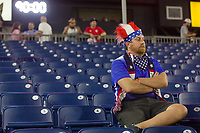 NASHVILLE, TN - SEPTEMBER 5: A USA Fans sits in the stands after a game between Canada and USMNT at Nissan Stadium on September 5, 2021 in Nashville, Tennessee.
