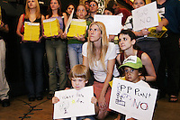 Opponents and proponents of the proposed Williamsburg, Brooklyn waterfront TransGas Energy power attend a contentious public hearing held in Brooklyn on July 17, 2003.