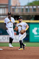 Bradenton Marauders second baseman Jesse Medrano (3) throws to first base as shortstop Oneil Cruz (13) backs up the play during a Florida State League game against the Charlotte Stone Crabs on April 10, 2019 at LECOM Park in Bradenton, Florida.  Bradenton defeated Charlotte 2-1.  (Mike Janes/Four Seam Images)