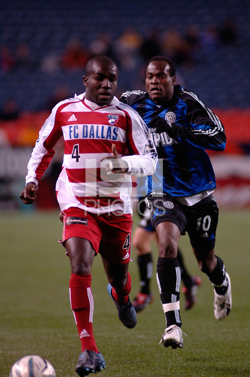 FC Dallas defender Chris Gbandi is chased down by Colorado forward Jean Phillippe Peguero. The Colorado Rapids drew 0-0 with FC Dallas in the first game of the Western Conference Semi-finals Invesco Field at Mile High, Denver, Colorado, September 22, 2005.