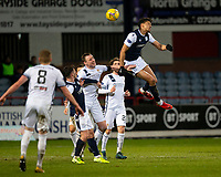 29th December 2020; Dens Park, Dundee, Scotland; Scottish Championship Football, Dundee FC versus Alloa Athletic; Osman Sow of Dundee dominates in the air against Andy Graham of Alloa Athletic