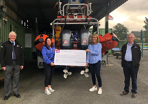 Lough Ree RNLI's Damien Delaney (left) and treasurer Vincent Rafter (right) with swimmers Karen Reynolds and Serena Friel as they present their donation cheque