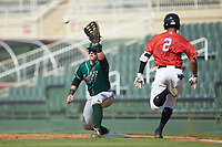 Greensboro Grasshoppers first baseman Mason Martin (35) stretches for a throw as Lenyn Sosa (2) of the Piedmont Boll Weevils hustles down the line at Kannapolis Intimidators Stadium on June 16, 2019 in Kannapolis, North Carolina. The Grasshoppers defeated the Boll Weevils 5-2. (Brian Westerholt/Four Seam Images)