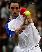 Serbian  Davis Cup player Viktor Troicki returns the ball during his match against Michael Llodra of France, Davis Cup finals, Serbia vs France in Belgrade Arena in Belgrade, Serbia, Sunday, 5. December 2010. (credit & photo: Pedja Milosavljevic/SIPA PRESS)