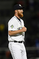 Closer Trey Cobb (26) of the Columbia Fireflies pumps his fist after a final strikeout against the Augusta GreenJackets on Opening Day, Thursday, April 5, 2018, at Spirit Communications Park in Columbia, South Carolina. Columbia won, 4-2. (Tom Priddy/Four Seam Images)