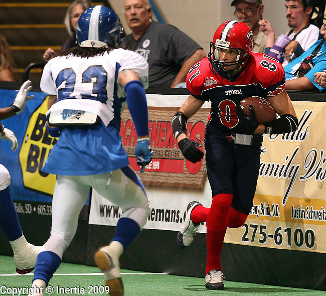 SIOUX FALLS, SD - JUNE 13:  Ben Nelson #81 of the SIoux Falls Storm sprints down the sideline as Jovan Jackson #23 of the Billings Outlaws closes in during the first quarter of their game Saturday night at the Sioux Falls Arena. (Photo by Dave Eggen/Inertia).