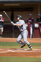 Kal Simmons (10) of the Kennesaw State Owls follows through on a solo home run in the top of the first inning against the Winthrop Eagles at the Winthrop Ballpark on March 15, 2015 in Rock Hill, South Carolina.  The Eagles defeated the Owls 11-4.  (Brian Westerholt/Four Seam Images)