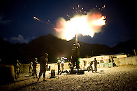 US Army soldiers from Charlie Battery, 3rd Battalion, 321st Field Artillery Regiment fire their 155mm canon at Firebase Sloan, Forward Operating Base (FOB) Blessing in the Pesh Valley. They fired illumination rounds to support the Afghan National Police (ANP) who were under attack from Taliban fighters at the Chapadara District Centre in the adjoining valley. The unit is the busiest artillery unit in the world having fired 6,426 rounds since deployment in February 2008.