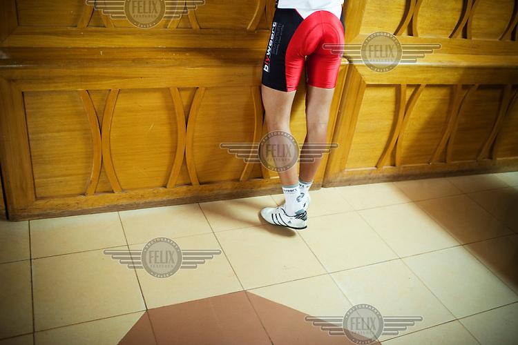 A cyclist at the reception of the Tour du Faso participants hotel in Ouagadougou.