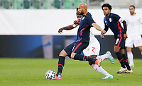 ST. GALLEN, SWITZERLAND - MAY 30: John Brooks #6 of the United States passes off the ball during a game between Switzerland and USMNT at Kybunpark on May 30, 2021 in St. Gallen, Switzerland.