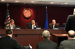 Gaming Control Board members A.G. Burnett, left, Chairman Mark Lipparelli, center, and member Shawn Reid work in a meeting in Carson City, Nev., on Wednesday, Dec. 7, 2011. .Photo by Cathleen Allison