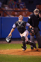 Wisconsin-Milwaukee Panthers catcher Daulton Varsho (10) looks for a foul ball popup in front of umpire Jeff Gould during a game against the Ball State Cardinals on February 26, 2016 at Chain of Lakes Stadium in Winter Haven, Florida.  Ball State defeated Wisconsin-Milwaukee 11-5.  (Mike Janes/Four Seam Images)