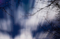 Clouds rush through the starry sky on a windy night, November 26, 2004 in Doylestown, Pennsylvania.