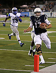 Nevada quarterback Cody Fajardo scores in an NCAA football game against Air Force in Reno, Nev., on Saturday, Sept. 28, 2013.<br /> Photo by Cathleen Allison