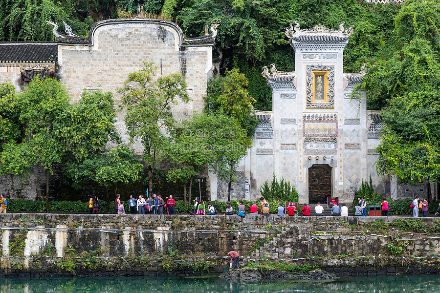 Zhenyuan, Guizhou, China.  Tourists outside the Entrance to the Black Dragon Cave Palace (Qinglong cave).