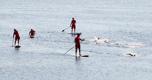 24 JUL 2010 - LONDON, GBR - Lifeguards watch over competitors during the Junior Aquathlon at the ITU World Championship Series race (PHOTO (C) NIGEL FARROW)
