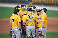 Siena Saints head coach Tony Rossi (40) talks with Brian Kelly (14), Patrick Ortland (27), Rich Gilbride (5), Tommy Miller (42), Joe Drpich (47), and Jordan Bishop (4) during a game against the Pittsburgh Panthers on February 24, 2017 at Historic Dodgertown in Vero Beach, Florida.  Pittsburgh defeated Siena 8-2.  (Mike Janes/Four Seam Images)
