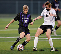 Waunakee's Charlie Steck (22) fights for the ball against Oregon's Micah Mitchell (16), as Oregon takes on Waunakee in Wisconsin WIAA Badger Conference boys high school soccer on Tuesday, Apr. 27, 2021 at Waunakee High School