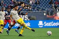 FOXBOROUGH, MA - MAY 16: Artur #8 Columbus SC passes the ball under pressure from Carles Gil during a game between Columbus SC and New England Revolution at Gillette Stadium on May 16, 2021 in Foxborough, Massachusetts.