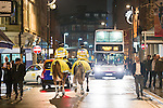 """© Joel Goodman - 07973 332324 . NO SYNDICATION PERMITTED . 19/12/2014 . Manchester , UK . Mounted police on patrol on Thomas Street . """" Mad Friday """" revellers out in the rain and cold in Manchester . Mad Friday is typically the busiest day of the year for emergency services , taking place on the last Friday before Christmas when office Christmas parties and Christmas revellers enjoy a night out .  Photo credit : Joel Goodman"""