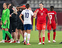 KASHIMA, JAPAN - AUGUST 2: Carli Lloyd #10 of the USWNT shakes hands with Christine Sinclair #12 of Canada after a game between Canada and USWNT at Kashima Soccer Stadium on August 2, 2021 in Kashima, Japan.