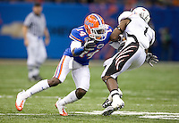 01 January 2010:  Markihe Anderson of Florida tackles Mardy Gilyard of Cincinnati during the game during Sugar Bowl at the SuperDome in New Orleans, Louisiana.  Florida defeated Cincinnati, 51-24.