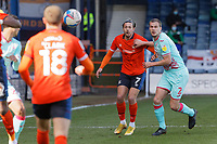 Ryan Bennett of Swansea City (R) challenged by Harry Cornick of Luton Town during the Sky Bet Championship match between Luton Town and Swansea City at Kenilworth Road, Luton, England, UK. Saturday 13 March 2021