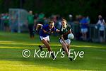 Kerrys Leona O'Sullivan gets ahead of Aoibhe Maher of   Tipperary in the Munster LGFA U14 football championship