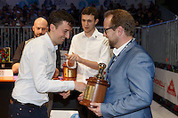 MELBOURNE, 26 MAY - Colin HARMON from Ireland receives a trophy from Carl Sara and celebrates coming 4th in the 2013 World Barista Championship held at the Melbourne Show Grounds in Melbourne, Australia. Photo Sydney Low / syd-low.com