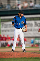 Missoula Osprey relief pitcher Jake Polancic (30) looks in for the sign during a Pioneer League game against the Orem Owlz at Ogren Park Allegiance Field on August 19, 2018 in Missoula, Montana. The Missoula Osprey defeated the Orem Owlz by a score of 8-0. (Zachary Lucy/Four Seam Images)