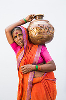 Jijabai Kore, 60, collects 10 pots of water everyday from government tankers which deliver water to the village of Sayyad Ankulga near the drought-hit city of Latur.