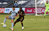 KANSAS CITY, KS - AUGUST 25: Alan Pulido #9 of Sporting Kansas City shields the ball from Maynor Figueroa #15 of Houston Dynamo during a game between Houston Dynamo and Sporting Kansas City at Children's Mercy Park on August 25, 2020 in Kansas City, Kansas.