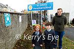 Mike O'Toole (Principal of St Johns Parochial School) with Grace Power and Levi Bernard Heaslip showing the new signage at St Johns Parochial School on Tuesday.