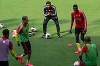 Watford caretaker manager Hayden Mullins (centre top) warms up the players ahead of the Premier League match between Watford and Manchester City at Vicarage Road, Watford, England on 21 July 2020. Football Stadiums around remain empty due to the Covid-19 Pandemic as Government social distancing laws prohibit supporters inside venues resulting in all fixtures being played behind closed doors until further notice.<br /> Photo by Andy Rowland.