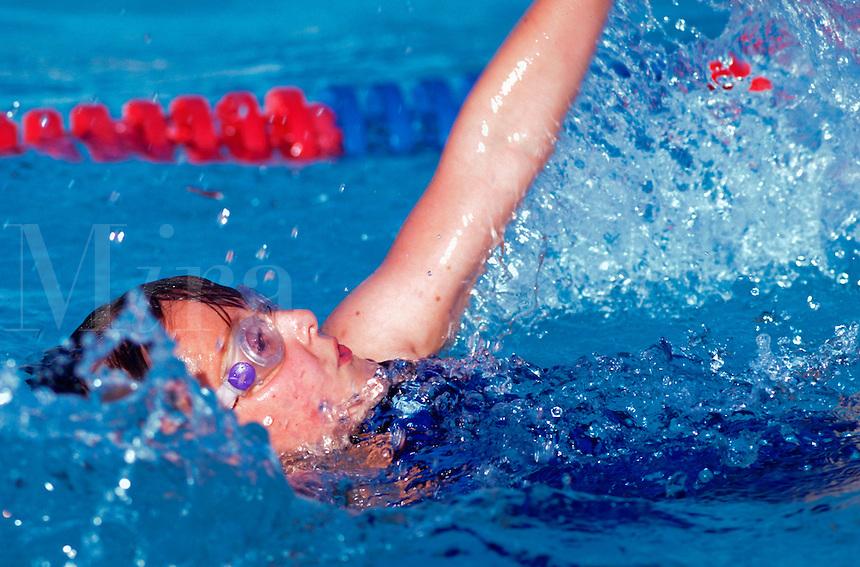 A female swimmer doing backstroke.