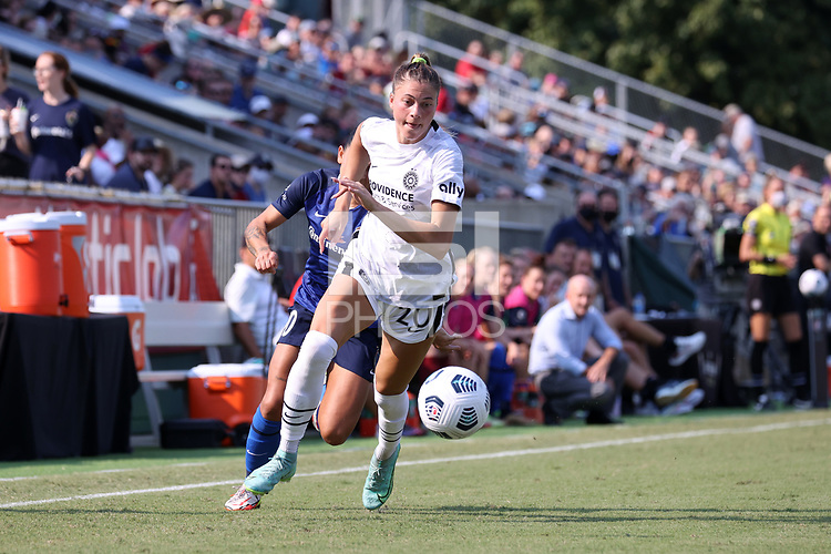 CARY, NC - SEPTEMBER 12: Kelli Hubly #20 of the Portland Thorns FC chases the ball during a game between Portland Thorns FC and North Carolina Courage at Sahlen's Stadium at WakeMed Soccer Park on September 12, 2021 in Cary, North Carolina.