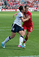 02 June 2013: U.S. National Women's Team player Abby Wambach #20 battles with Canadian Women's player Emily Zurrer #2 during an international friendly soccer match between the U.S Women's National Team and the Canadian Women's National Team at BMO Field in Toronto, Ontario Canada.