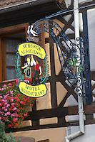 wrought iron sign hotel restaurant auberge alsacienne eguisheim alsace france