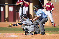Kennesaw State Owls catcher Drew Davis (16) sets a target as home plate umpire Clint Lawson looks on during the game against the Winthrop Eagles at the Winthrop Ballpark on March 15, 2015 in Rock Hill, South Carolina.  The Eagles defeated the Owls 11-4.  (Brian Westerholt/Four Seam Images)