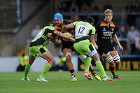 James Haskell of Wasps is tackled by Calum Clark and Luther Burrell of Northampton Saints during the Premiership Rugby Round 2 match between Wasps and Northampton Saints at Adams Park on Sunday 14th September 2014 (Photo by Rob Munro)