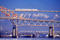 Bridges over Fraser River, New Westminster to Surrey, BC, British Columbia, Canada - Skytrain on SkyBridge, Patullo Bridge, and New Westminster (Train) Bridge (aka Fraser River Swing Bridge - Coast Mountains in background