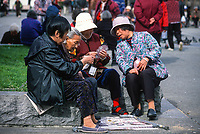 San Francisco, California, Chinatown. Chinese Women Playing Cards in Portsmouth Square.