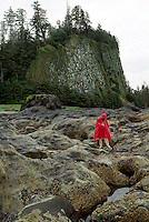 Haida Gwaii (Queen Charlotte Islands), Northern BC, British Columbia, Canada - Hiker exploring Tidal Pools at Tow Hill and North Beach along McIntyre Bay, Naikoon Provincial Park, Graham Island (Model Released)